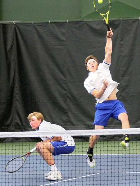 PMG PHOTO: MILES VANCE  - A duo of senior Quentin Nigbur and junior Michael Hopkins lost 6-1, 6-1 in the first round of the OSAA 6A doubles playoffs.