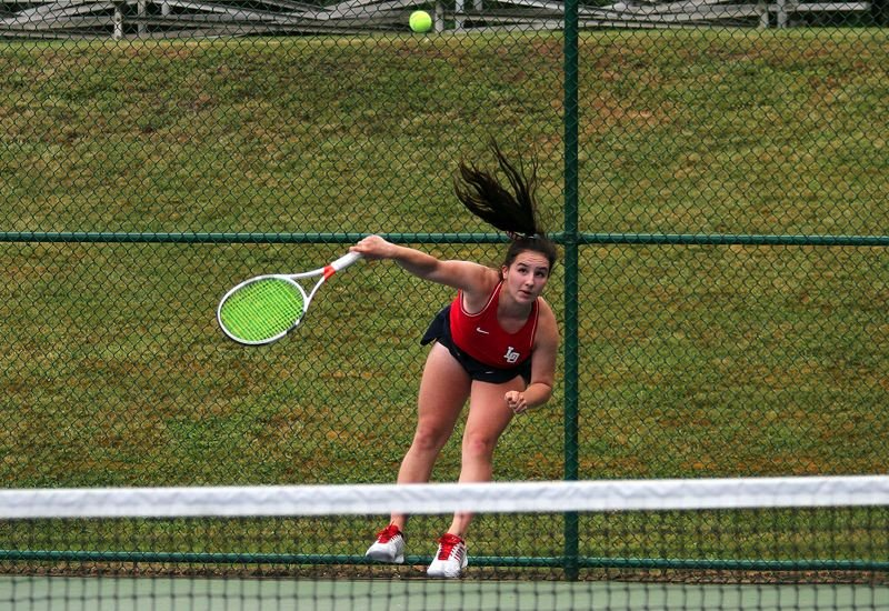 PMG PHOTO: MILES VANCE - Lake Oswego sophomore Mariam Nechiporuk makes a serve during her quarterfinal match in the Class 6A state tournament at the Babette Horenstein Tennis Center on Friday, May 17.