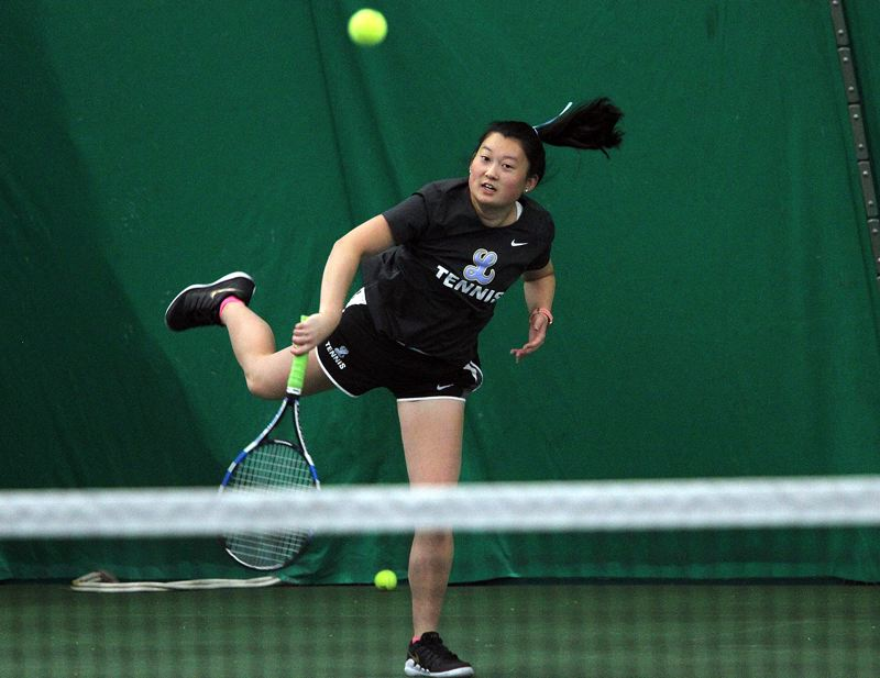 PMG PHOTO: MILES VANCE - Lakeridge senior Gigi Davies makes a serve during doubles competition in the Class 6A state tennis tournament at the Babette Horenstein Tennis Center on Friday, May 17.