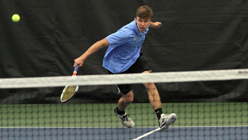 PMG PHOTO: MILES VANCE - Lakeridge senior Andrew Slominski makes a backhand during his doubles quarterfinal match in the Class 6A state tournament at the Babette Horenstein Tennis Center on Friday, May 17.