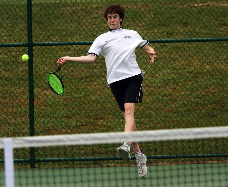PMG PHOTO: MILES VANCE - Lake Oswego's Connor Whittington gets ready to hit a forehand during his singles quarterfinal match in the Class 6A state tournament at the Babette Horenstein Tennis Center on Friday, May 17.