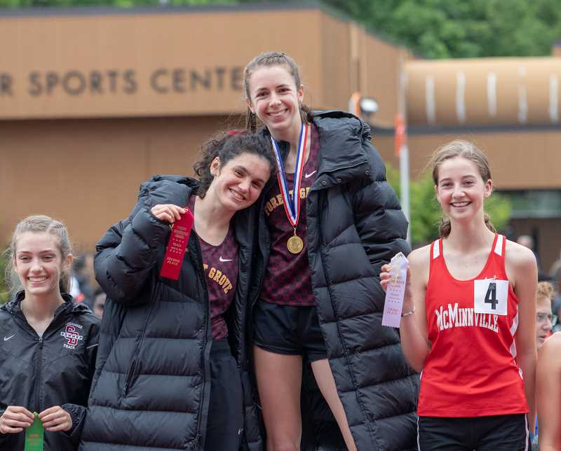 COURTESY PHOTO - Forest Grove's Elizabeth Khoury (right) and Hannah Aguirre (left) celebrate their 1-2 finish in the 1500 meters at last week's Pacific Conference Track & Field Championships at George Fox University in Newberg.