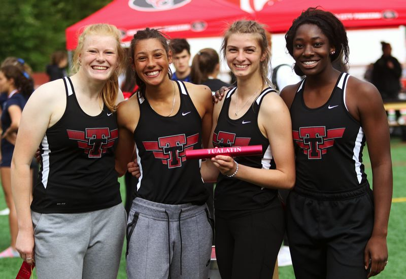 PMG PHOTO: DAN BROOD - Tualatin's (from left) Jessica Olson, Gennavieve Marion, Corona Parker and Amerrah Horne-Vaden took second place in the 4 x 100 relay to earn a trip to this week's Class 6A state meet.