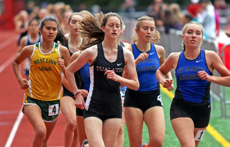 PMG PHOTO: DAN BROOD - Tualatin junior Kaitlyn Gearin (second from left), shown here in the 1,500-meter run, won both that event and the 3,000 at the Three Rivers League district meet.
