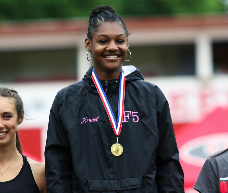 PMG PHOTO: DAN BROOD - Tualatin High School sophomore Kendel Vanterpool won the championship in the triple jump at the Three Rivers League district track and field meet.