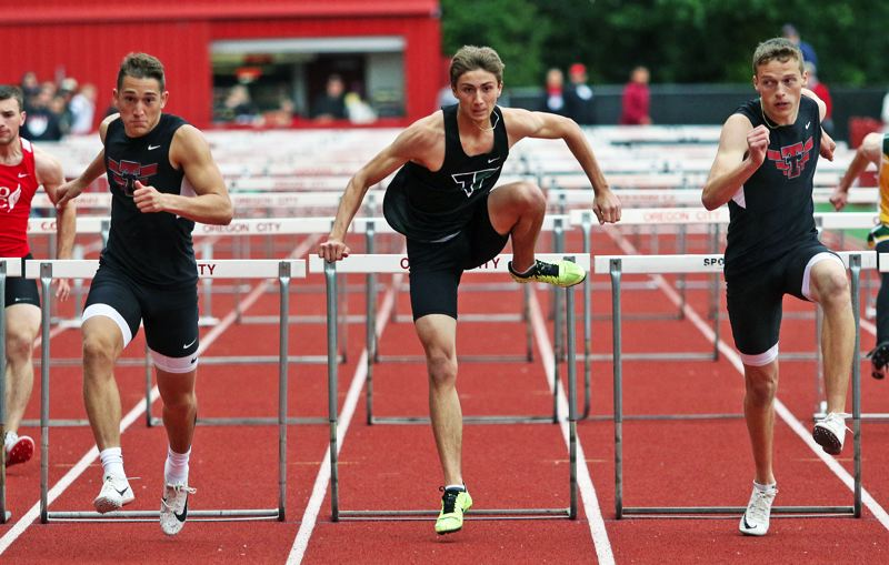 PMG PHOTO: DAN BROOD - Tualatin High School junior Luke Marion (left) edged Tigard's Jaaron Kletzel (center) and Tualatin senior Jalen Hale to win the 110-meter high hurdles event at the TRL district meet.