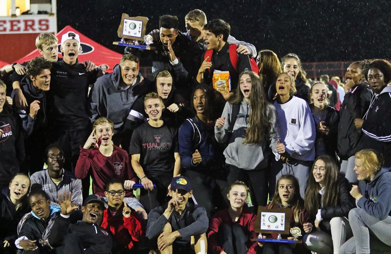 PMG PHOTO: DAN BROOD - The Tualatin High School boys and girls track and field squads swept the team championships at the Three Rivers League district meet.