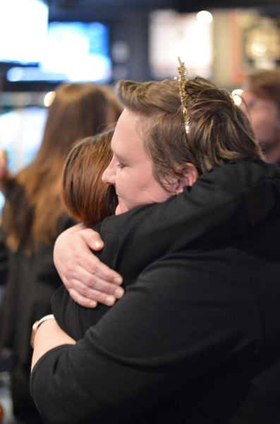 PMG PHOTO: CLARA HOWELL - Candidate Jordan Ferris (right) receives a hug Tuesday night after election returns showed her lagging slightly behind fellow  candidate Christy Thompson.