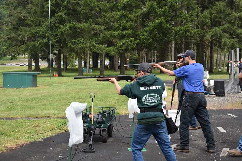PMG PHOTO: EMILY LINDSTRAND - Members of the Estacada High School clay target team practice shooting.