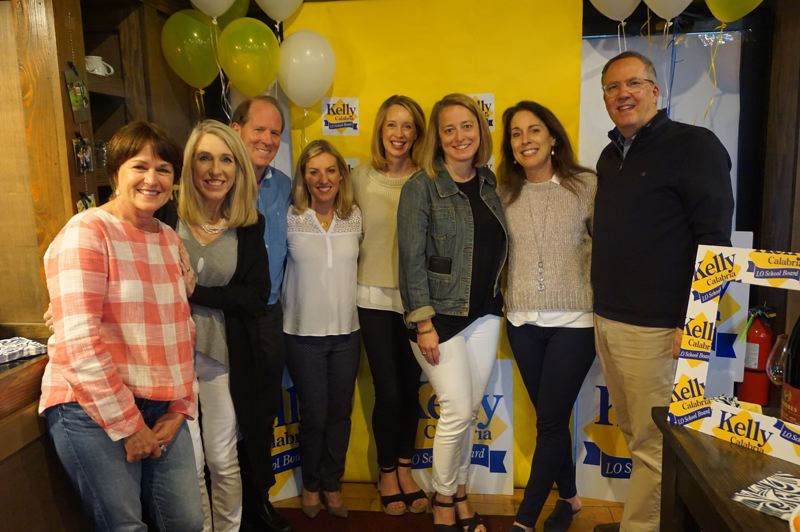 PMG PHOTO: CLAIRE HOLLEY - Kelly Calabria (fourth from left) and her supporters gathered at Oregon Wine Reserve in downtown Lake Oswego to await election results.