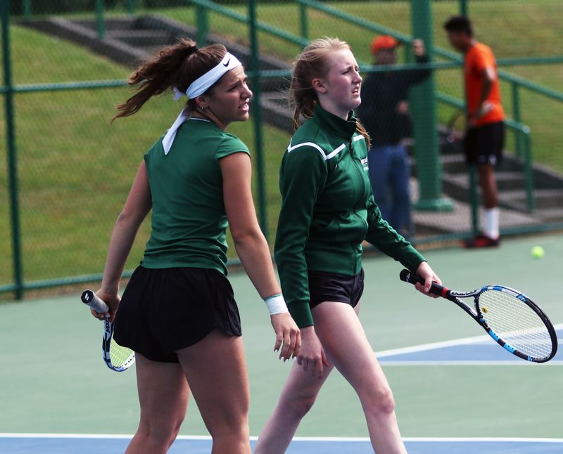 PMG PHOTO: DAN BROOD - Tigard High School senior Nicole Mazzeo (left) and sophomore Ali Dreves won the girls doubles consolation title at the Class 6A state tennis tournament.