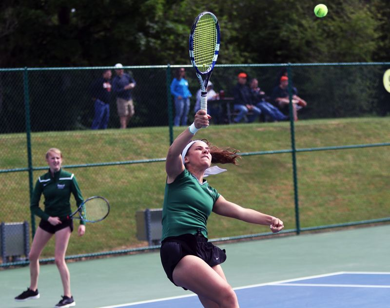 PMG PHOTO: DAN BROOD - Tigard High School senior Nicole Mazzeo hits an overhand shot during the Tigers' consolation bracket semifinal match at the Class 6A state tournament.