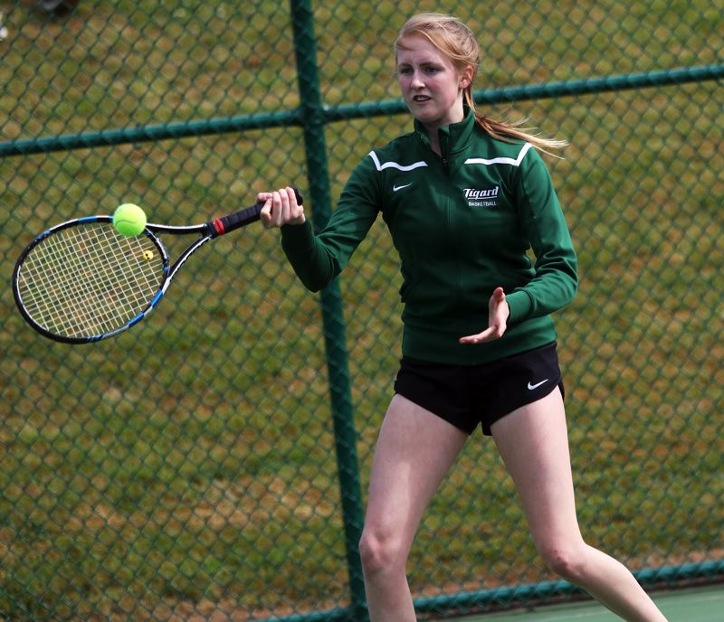 PMG PHOTO: DAN BROOD - Tigard High School sophomore Ali Dreves hits a shot during the Tigers' girls doubles consolation semifinal match at the Class 6A state tournament.