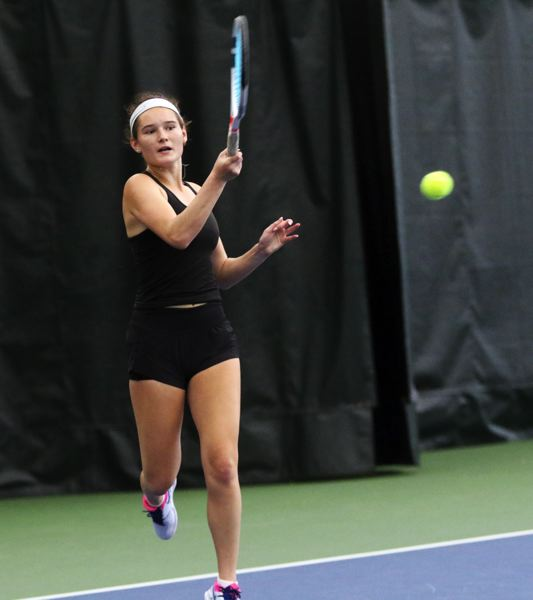 PMG PHOTO: DAN BROOD - Tualatin High School senior Jensen Barnes hits a shot during her 6-0, 6-0 first round victory at the Class 6A state tennis tournament.
