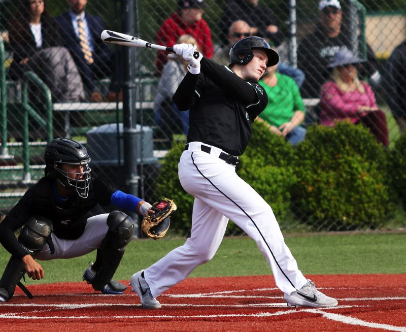 PMG PHOTO: DAN BROOD - Tigard High School senior Fletcher Ahl hits a first-inning single during the Tigers' 7-6 state playoff win over South Medford.