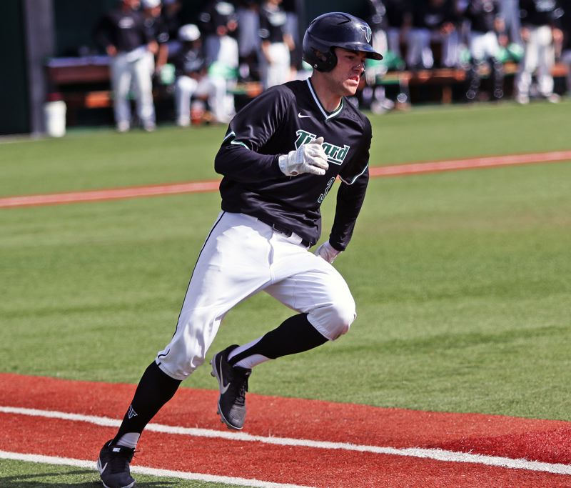 PMG PHOTO: DAN BROOD - Tigard High School senior Lance Kreisberg gets ready to round first base during the Tigers' 7-6 state playoff win over South Medford.