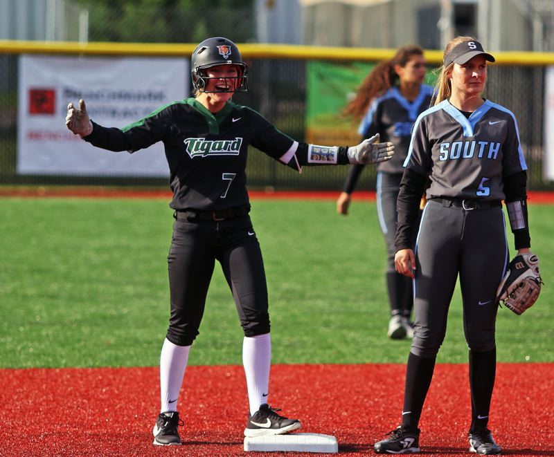 PMG PHOTO: DAN BROOD - Tigard High School junior Lexi Klum smiles toward the Tigard dugout after hitting a third-inning double during the Tigers' 9-1 state playoff win over South Salem.