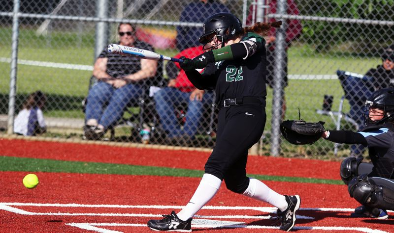 PMG PHOTO: DAN BROOD - Tigard High School junior Emily Paulson puts the ball in play during the Tigers' 9-1 state playoff win over South Salem.