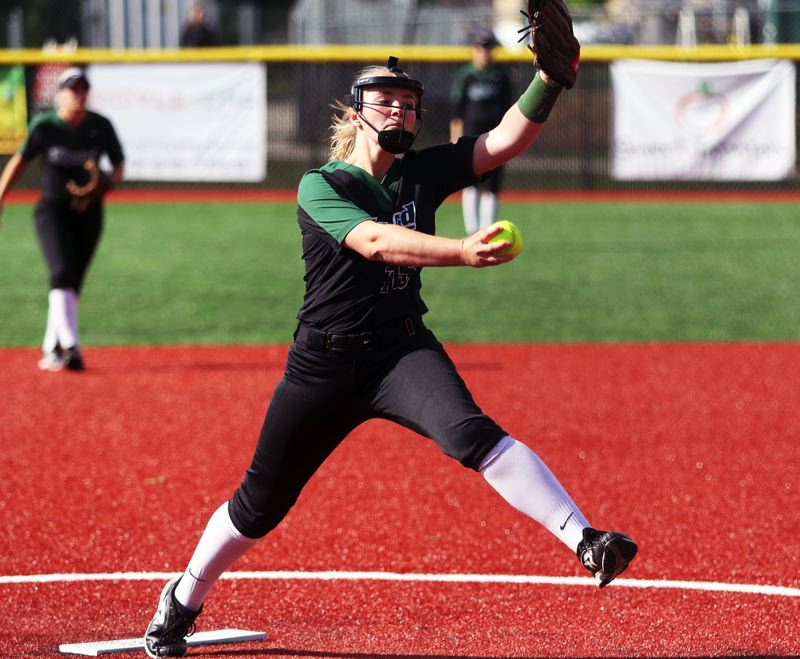 PMG PHOTO: DAN BROOD - Tigard High School sophomore Sophia vanderSommen gets ready to fire in a pitch during the Tigers' state playoff win over South Salem.
