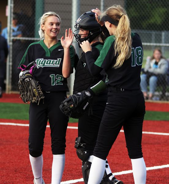 PMG PHOTO: DAN BROOD - Tigard's (from left) Makenna Reid, Emily Paulson and Laura Masters are all smiles following the Tigers' 9-1 win over South Salem in Monday's state playoff game.