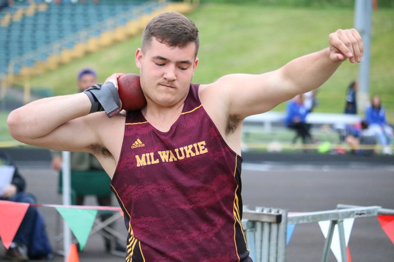 PMG PHOTO: JIM BESEDA - Milwaukie's Kaiden Durheim survived a rough preliminary round and then popped a personal best 49-7 3/4 to win the boys shot put title at last week's NWOC track and field championships.