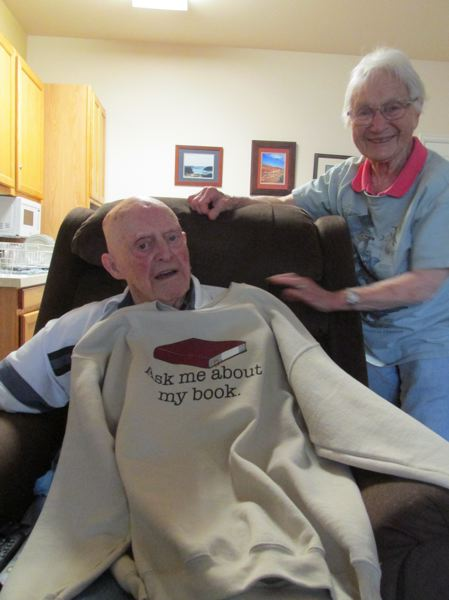 PMG PHOTO: TERESA CARSON - Slagle and Ott show off a sweatshirt a fan gave him after the book was published.