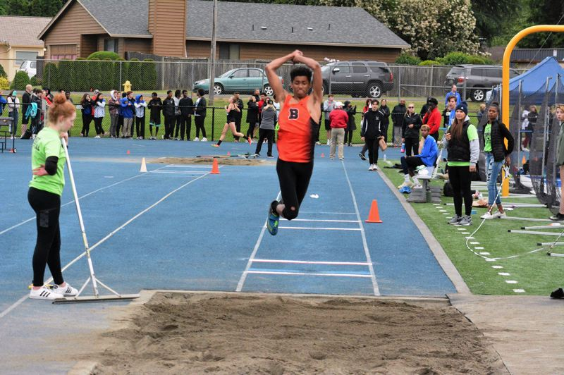 TIMES PHOTO: MATT SINGLEDECKER - Beaverton junior Nathan Reed won the triple jump and took second in the long jump at the Metro League district meet last week.