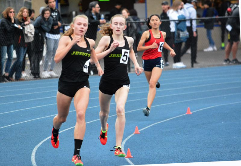 TIMES PHOTO: MATT SINGLEDECKER - Jesuit freshman Chloe Forester and sophomore Molly Grant took first and second in the 800 meters.