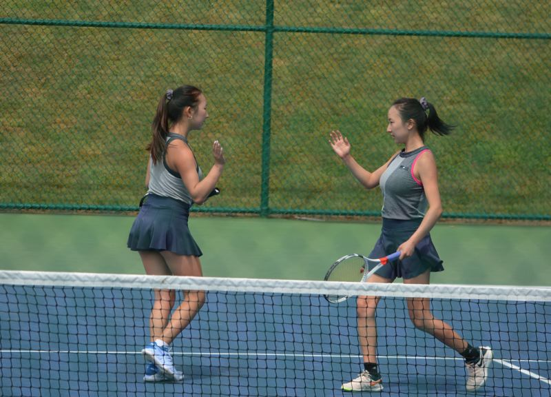 TIMES PHOTO: MATT SINGLEDECKER - Sunset juniors Bo Bae and Jin Yu won the Class 6A doubles state championship last week.