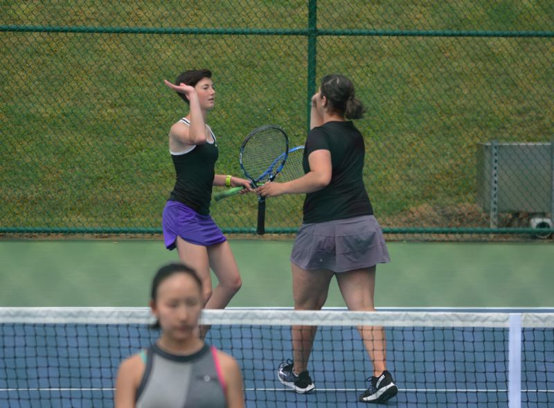 TIMES PHOTO: MATT SINGLEDECKER - Sunset doubles partners Lucy Erickson and Yara Chehab placed second at the Class 6A doubles state championship last week.