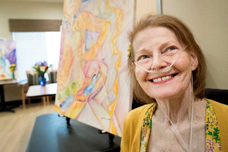PMG PHOTO: JAIME VALDEZ - Pam Benet smiles as she see guests arrive at Marquis Post Acute Rehab Center to see her artwork in Tualatin last Friday.