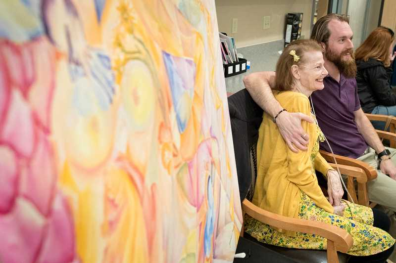 PMG PHOTO: JAIME VALDEZ - Pam Benet and her son, Skye Bennet, pose for pictures during Pams art show at Marquis Post Acute Rehab Center last Friday in Tualatin.