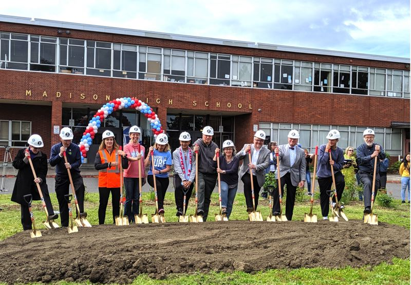 PMG PHOTO: COURTNEY VAUGHN - Portland Public Schools board members and U.S. Rep. Earl Blumenauer (second from left) dig in during a groundbreaking ceremony at Madison High School to commemorate the forthcoming remodel of the school.
