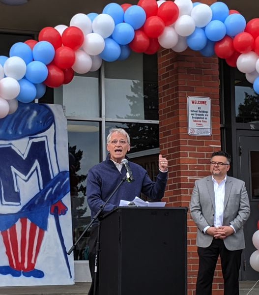 PMG PHOTO: COURTNEY VAUGHN - U.S. Rep Earl Blumenauer speaks to parents, students and community members during a groundbreaking ceremony at Madison High School Satueday, May 18. To the right, PPS Superintendent Guadalupe Guerrero looks on.