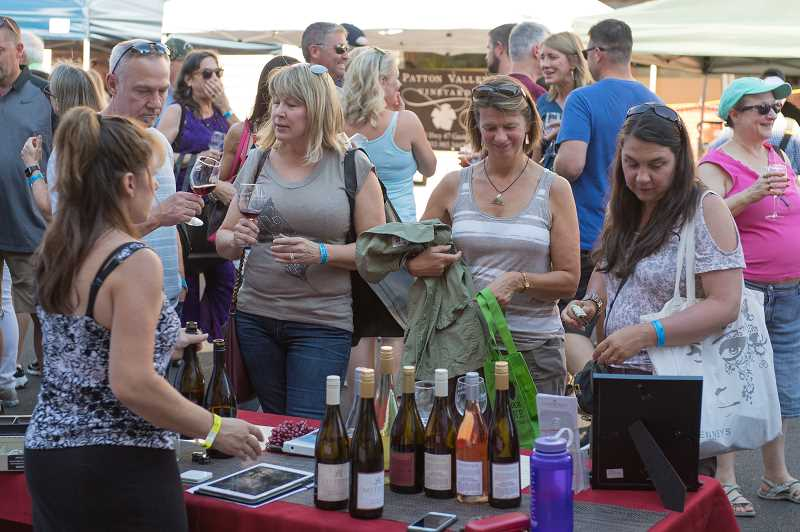 PMG PHOTO: CHRISTOPHER OERTELL - UnCorked! is a street festival raising money for public safety programs in the local area, with wine, food, live music and more.
