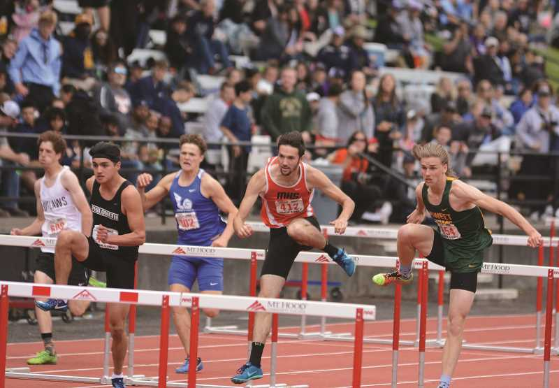 PMG PHOTO: DAVID BALL - Molalla senior Nick Lucas took third place in the 110-meter hurdles.