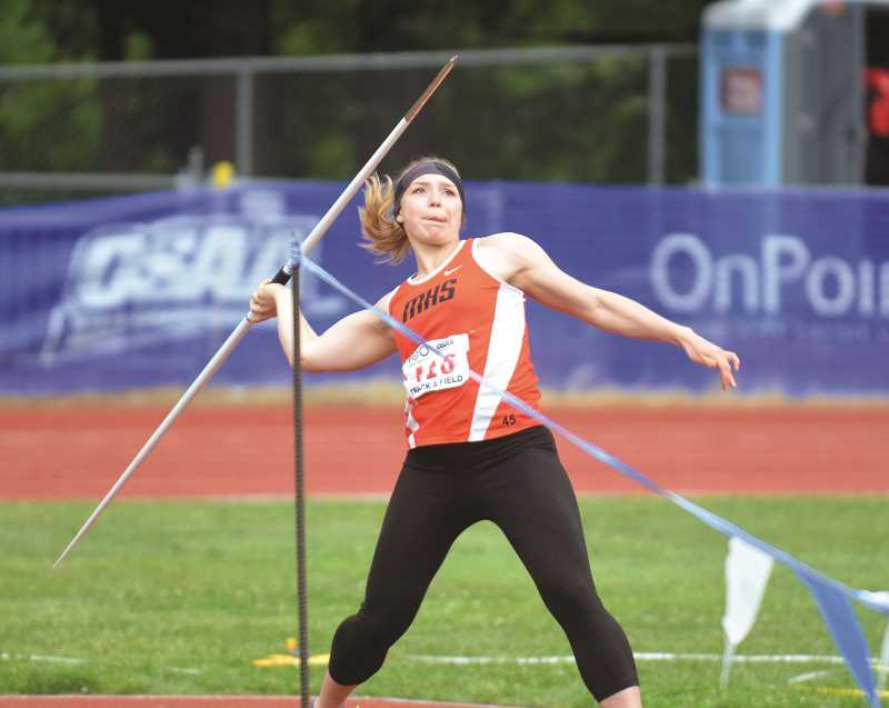 "PMG PHOTO: TANNER RUSS - Country Christian senior and Molalla track athlete Katie Sandberg took seventh in the javelin with a throw of 113'10""."