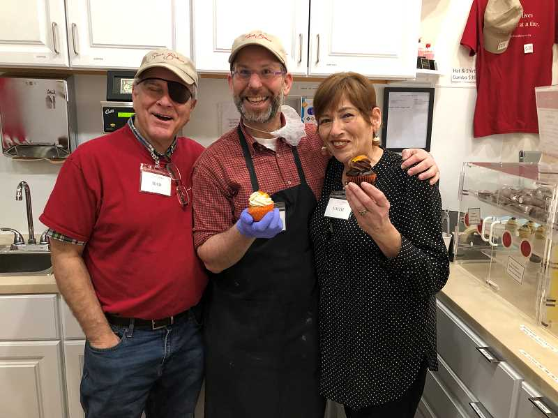 From left are Had Walmer, a baker with brain injury, Sarah Bellums founder Rik Lemoncello and Faith Walmer, who serves as outreach director for Sarah Bellums Bakery and Workshop.