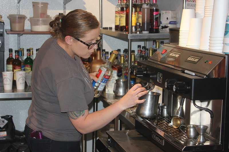 DESIREE BERGSTROM/MADRAS PIONEER - Specialty coffee drinks are still very much available at Dancing Beans. Above, the general manager, Katie Fleischmann, prepares a concoction. Dancing Bean offers both breakfast and lunch.