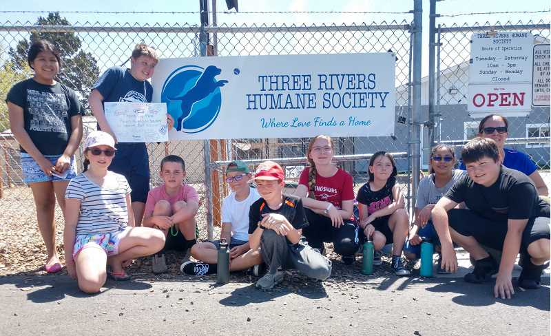 SUBMITTED PHOTO - Buff Elementary fourth and fifth grade students spent time volunteering at the Three Rivers Humane Society, where they washed puppies, played with dogs, and spent time with cats. Students included, from left, Elizabeth Diaz, Cadence Tippett, Kyler Stein, Lucas Hurd, Merrick Tower, Alex Irvine, Gabby Marino, Nichole Skeels, Maya Garcia, Brock Etter and counselor and club advisor Tracey Sklenar.