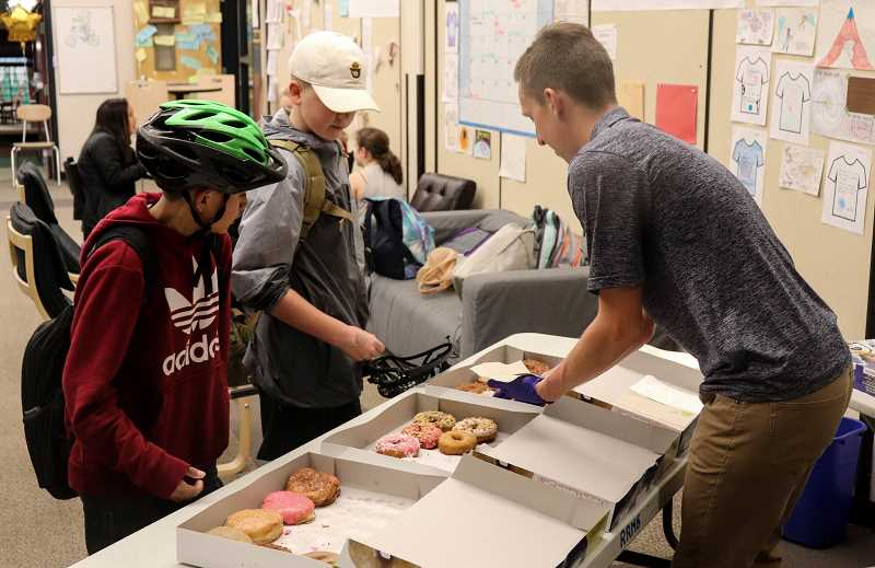 COURTESY PHOTO: ANDREW KILSTROM - Students who participated in National Walk and Bike to School Day received doughnuts, certificates of participation and supplies.