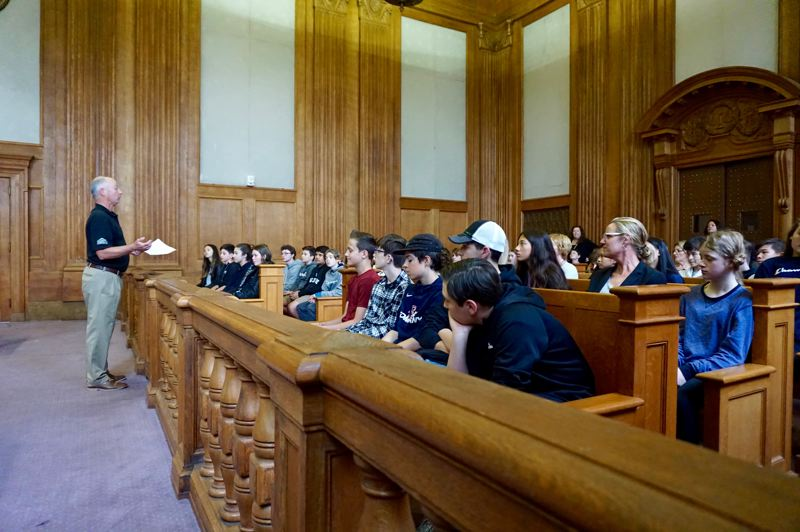 PMG PHOTO: CLAIRE HOLLEY - Classroom Law Project tour guide Dean Vrooman explains the layout of the courtroom at the Gus Solomon Federal Courthouse.