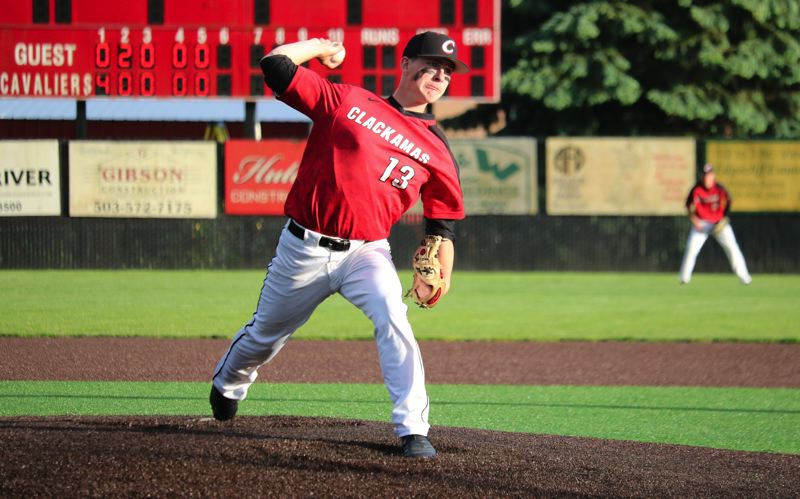 PMG PHOTO: JIM BESEDA - Clackamas reliever Kaiden Miller retired Summit in order in the seventh inning to nail down a 5-4 home win in Monday's opening round of the OSAA Class 6A baseball playoffs.