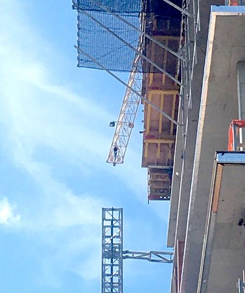 COURTESY PHOTO: OLIVIA SINGER - A man having a mental crisis climbed onto a construction crane in Southeast Portland Wednesday afternoon, May 22.