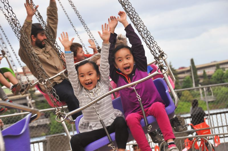 COURTESY: VERN UYETAKE/ROSE FESTIVAL - CityFair has fun for all ages at Waterfront Park, including carnival rides.