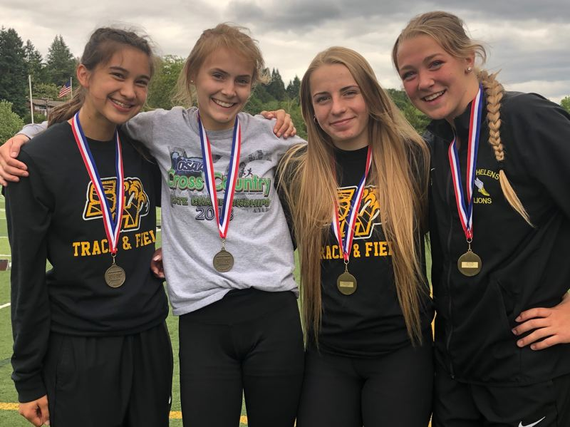PMG PHOTO: STEVE BRANDON - St. Helens' district champions in the 4x100-meter relay celebrate their victory at Putnam. From left: Kasten Warner, Hannah Hayduk, Isabelle Wallace and Savannah Moore.