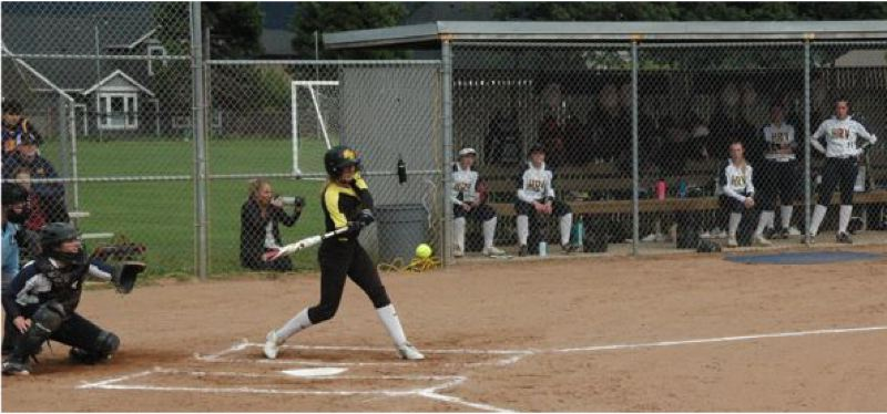 COURTESY PHOTO: MIKE WEBER - Kaily Smith connects at the plate for the St. Helens Lions in their 8-0 state playoff loss at Hood River Valley on Wednesday.