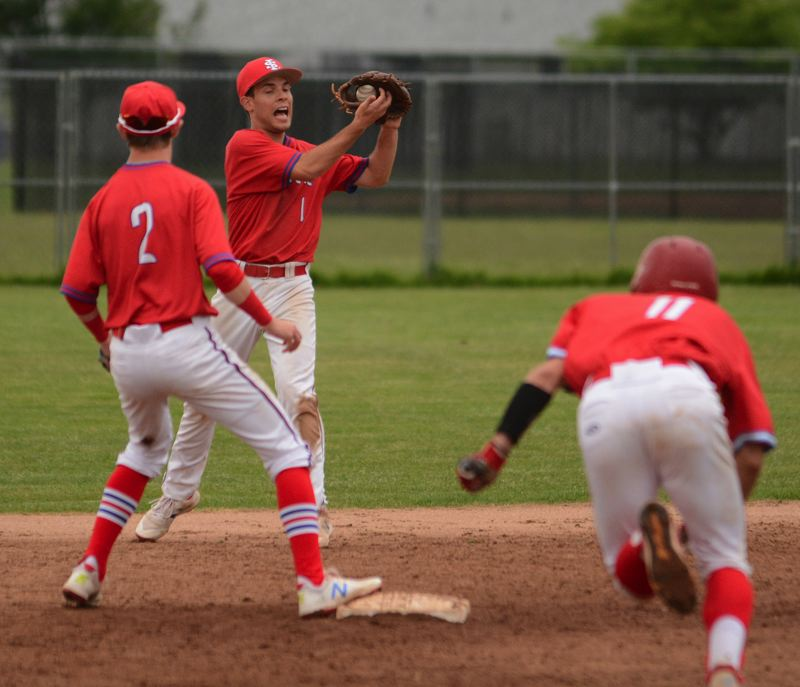 PMG PHOTO: DAVID BALL - La Salle Preps second baseman Isaac Kersey-Bronec hauls in a line drive to help the Falcons escape a bases-loaded threat in the sixth.