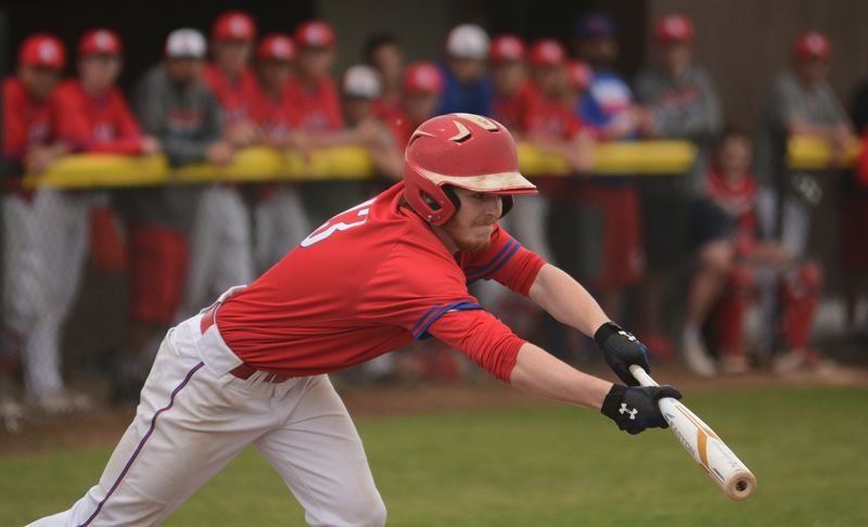 PMG PHOTO: DAVID BALL - La Salle Preps Spencer Paugh reaches out for a sacrifice bunt in his first at-bat of the game.