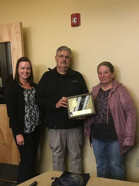 COURTESY OF SUSIE MARSTON - Retiring Gervais Police Chief Peter Spirup with Gervais City Manager Susie Marston, left, and Gervais Mayor Shanti Platt.